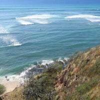 Surfers north of Diamond Head Lighthouse