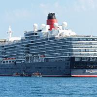 Queen Elizabeth was moored near Guernsey.  Note it is registered in Hamilton (Bermuda).  This allows them to host weddings on board.