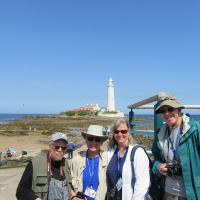 Phil, Ken, Mary Lee and Ron pose in front of St Mary's Lighthouse.