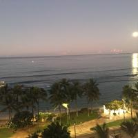 View from hotel room of Waikiki with full moon