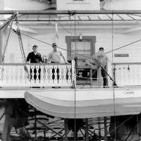 """API 032968-04; """"Crewmen lowering 'Boston Whaler' boat from Thomas Point Shoal Light Station, Maryland"""" 29 March 1968; photo by CWO J. Greco, USCG"""