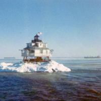 "Thomas Point Shoal Lighthouse ""encased"" in ice. Notice the merchant ships in the background."