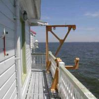 railing 	View of railing, deck, and a set of boat davits.