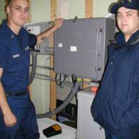 Coast Guardsmen from Activities Baltimore stand by their automation equipment on the 2nd deck.