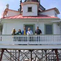 From left to right: Cullen Chambers, lead preservationist; Anne Puppa, Vice President for Preservation, Chesapeake Chapter, US Lighthouse Society; Henry Gonzalez, Vice President for East Coast Operations, US Lighthouse Society; Sandy Clunies, Historian, Chesapeake Chapter; Bob Trapani, President, Delaware River & Bay Lighthouse Foundation Photograph by Preston Burrows, US Coast Guard