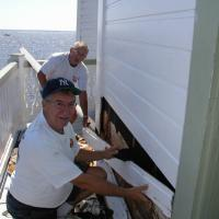Ray LeSage and Hobie Statzer removing rotted siding for replacement