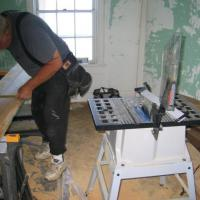 Al Pearson cutting wood for doorjamb and threshold replacement
