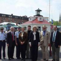 From left to right: CAPT Curt Springer, Commander Activities Baltimore, U.S. Coast Guard; Congressman Ben Cardin, 3rd District MD; RADM Brice-O'Hara; Ginger Ellis, Anne Arundel County, Environmental & Cultural Resources; Chief of Staff, IWIF; Secretary Norton; Mr. Wheeler, U.S. Lighthouse Society; and Mr. Gonzalez, U.S. Lighthouse Society.